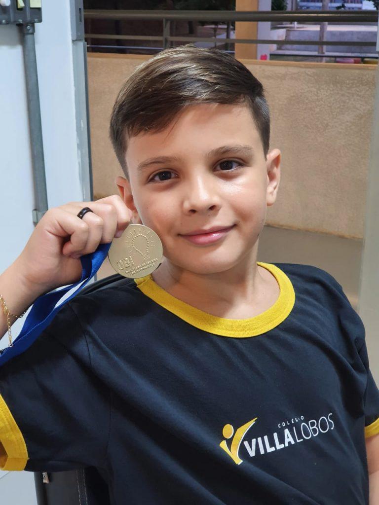 Estudante recebe medalha de ouro em Olimpíada do Conhecimento 5